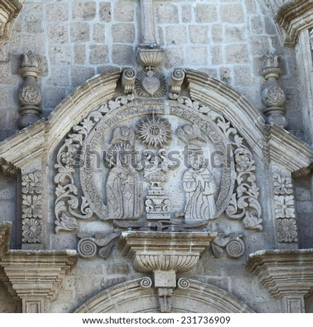 AREQUIPA, PERU - AUGUST 22, 2014: Detail of the artwork on the facade of San Francisco church on Zela Street on August 22, 2014 in Arequipa, Peru. Arequipa is an UNESCO World Cultural Heritage Site.  - stock photo
