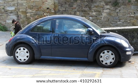 AREZZO, ITALY - CIRCA APRIL 2016: blue Volkswagen New Beetle car parked in a street of the city centre - stock photo