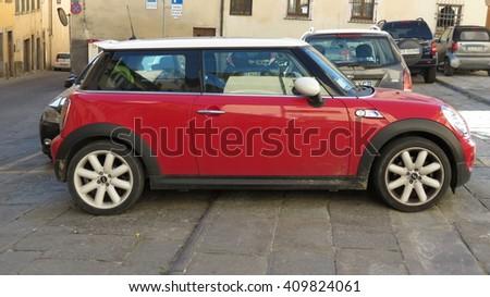 AREZZO, ITALY - CIRCA APRIL 2016: red Mini Cooper car with white roof - stock photo