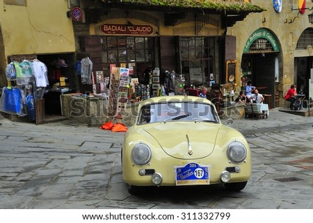 AREZZO, ITALY - SEPTEMBER 20: A yellow Porsche 356 A takes part to the GP Nuvolari classic car race on September 20, 2014 in Arezzo. The car was built in 1957 - stock photo