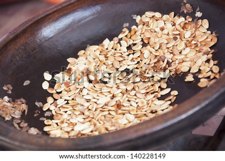 Argan kernels from the Argan tree, that is cultivated for the oil (argan oil) which is found in the fruit. The oil is rich in fatty acids and is used in cooking and cosmetics. - stock photo