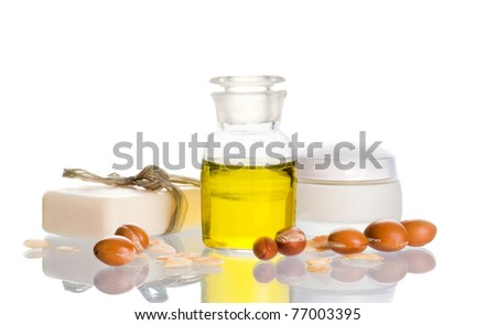 Argan oil used in cosmetic products with argan nuts. Argan nuts come from Morocco - stock photo