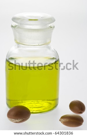 argan oil with nuts - stock photo