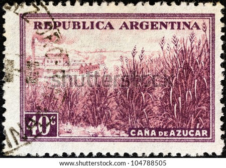 """ARGENTINA - CIRCA 1936: A stamp printed in Argentina from the """"Production and Industry"""" issue shows sugar cane and factory, circa 1936. - stock photo"""