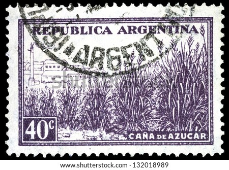 "ARGENTINA - CIRCA 1936: a stamp printed in Argentina shows Factory and field of Sugar Cane, with the same inscription, from the series ""Production and Industry"", circa 1936"