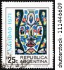 ARGENTINA - CIRCA 1971: a stamp printed in the Argentina shows Christ in Majesty, Tapestry by Horacio Butler in Basilica of St. Francis, Buenos Aires, Christmas, circa 1971 - stock photo