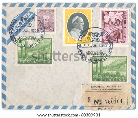 "ARGENTINA - CIRCA 1959: Vintage envelope and stamps in honor of Argentina National Exhibition with portrait of Pope Pius XII and inscription ""Exposicion nacional de Ganaperia"", series, circa 1959 - stock photo"
