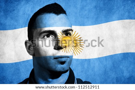Argentina flag painted on his face. - stock photo