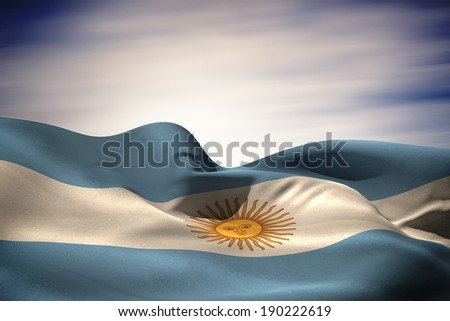 Argentina flag waving against blue cloudy sky - stock photo