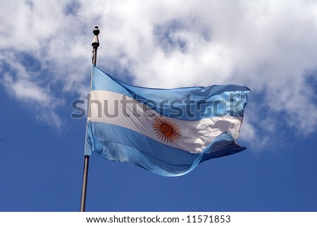 Argentina flag waving in the wind on a cloudy day - stock photo