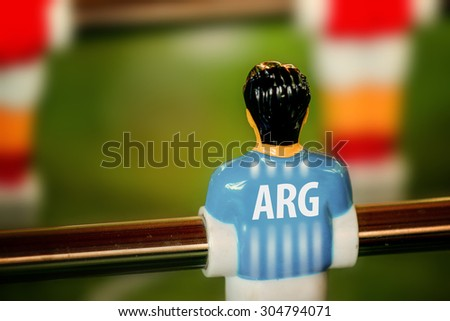 Argentina National Jersey on Vintage Foosball, Table Soccer or Football Kicker Game, Selective Focus, Retro Tone Effect - stock photo