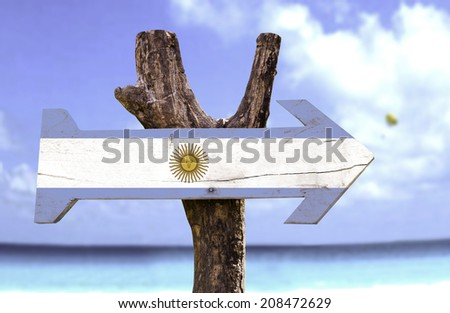 Argentina wooden sign with a beach on background  - stock photo