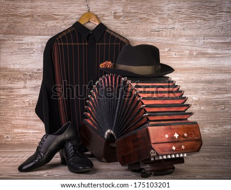 Argentine tango, still life composition with bandoneon on wooden background