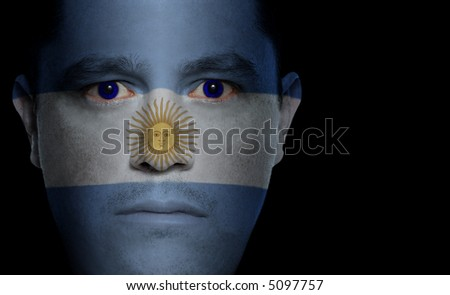 Argentinean flag painted/projected onto a man's face.