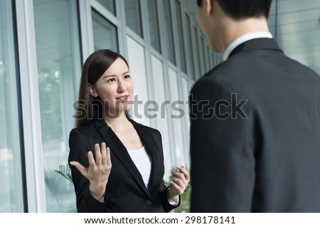 Argue concept of business woman and man in the city. - stock photo