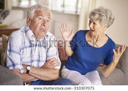 Argument of senior couple is no joke - stock photo