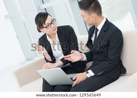 Argumentation process of businesspeople at office - stock photo