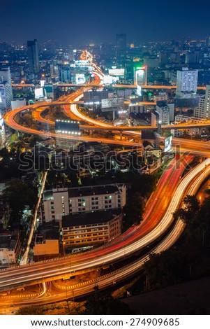 Arial view of Bangkok city with main traffic and express way at night - stock photo