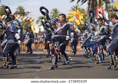 ARICA, CHILE - JANUARY 24, 2016: Caporales dance group in ornate costumes performing at the annual Carnaval Andino con la Fuerza del Sol in Arica, Chile. - stock photo