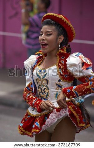 ARICA, CHILE - JANUARY 24, 2016: Caporales dancer in ornate red and white costume performing at the annual Carnaval Andino con la Fuerza del Sol in Arica, Chile.