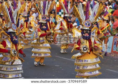 ARICA, CHILE - JANUARY 22, 2016: Morenada dance group  in traditional Andean costume performing at the annual Carnaval Andino con la Fuerza del Sol in Arica, Chile.  - stock photo