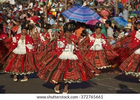 ARICA, CHILE - JANUARY 23, 2016: Morenada dancers in traditional Andean costume performing at the annual Carnaval Andino con la Fuerza del Sol in Arica, Chile.  - stock photo