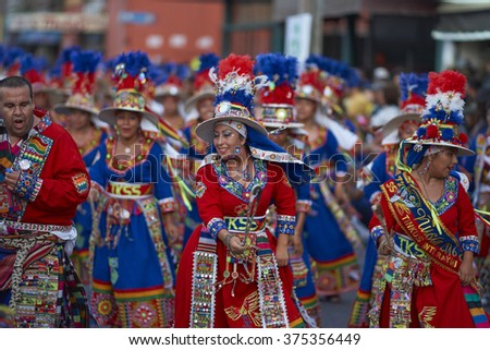 ARICA, CHILE - JANUARY 24, 2016: Tinku dancing group in colourful costumes performing a traditional ritual dance as part of the Carnaval Andino con la Fuerza del Sol in Arica, Chile. - stock photo