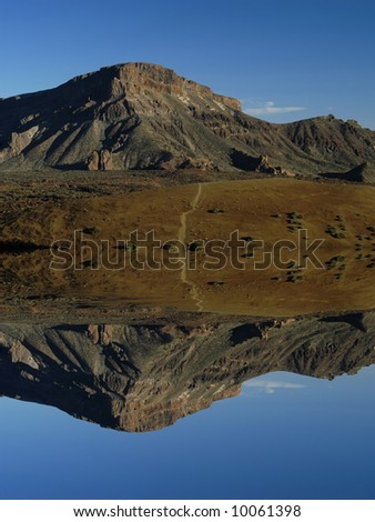 arid african mountain landscape with digital water reflection