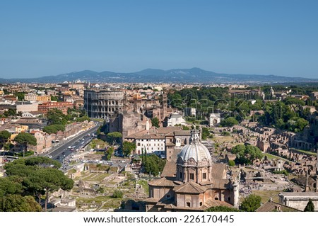 Ariel view of Rome: including the Colosseum and Roman Forum. (Rome - Italy)  - stock photo