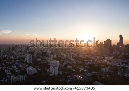Ariel view of urban city scape at sunset taken at dusk time