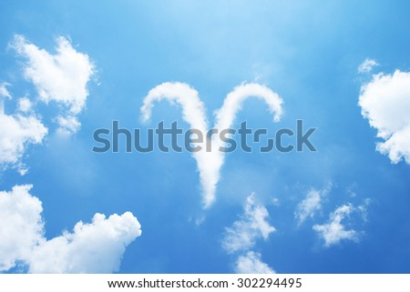 Aries cloud zodiac sign on sky. - stock photo