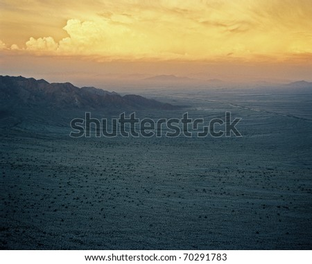 Arizona/California border with approaching storm - stock photo