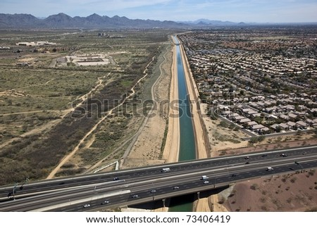 Arizona Canal running under State Route 51 - stock photo