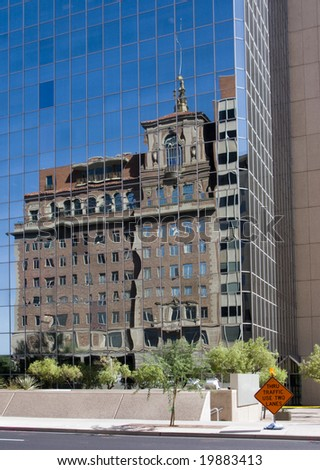 Arizona Historic House Reflection in Modern Phoenix Skyscraper - stock photo