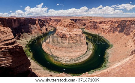 Arizona Horseshoe Bend on Colorado River, Glen Canyon with blue sky and white clouds - stock photo