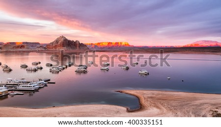 Arizona Lake Powell houseboats at sunset - stock photo
