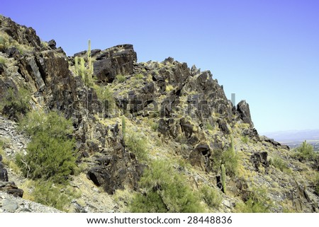 Arizona mountain against a blue sky, in horizontal orientation with copy space for text