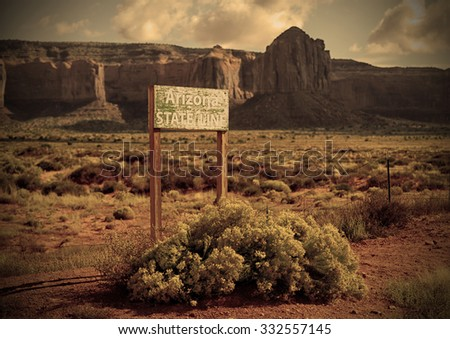 Arizona state line in Monument Valley with an old west feel - stock photo