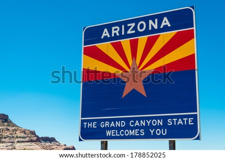 Arizone state border highway sign with a sky blue background - stock photo