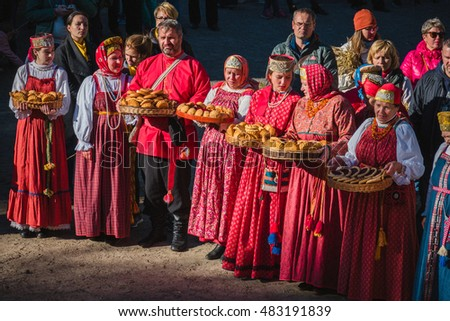 Arkhangelsk, Russia - September 11, 2016: the feast of bread in Small Karelians, Russian women in national costumes with loaves