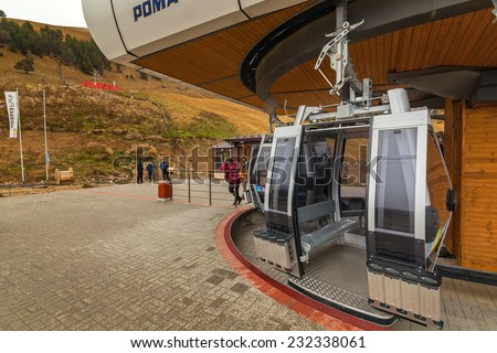 ARKHYZ, KARACHAY-CHERKESSIA, RUSSIA - OCTOBER 10 2014: Construction of ski resort Arkhyz park. First part of cable car line is fully functional. This fall part of resort is ready for guests. - stock photo
