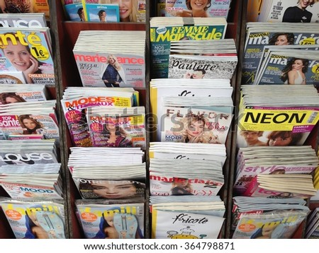 Arles,France- May 5,2013: Popular french magazines in french language displayed outside a newsstand in Arles,France - stock photo