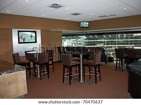 ARLINGTON - JAN 26: A view of a luxury suite in Cowboys Stadium in Arlington, Texas sight of Packers Steelers Super Bowl XLV. Taken January 26, 2011 in Arlington, TX. - stock photo