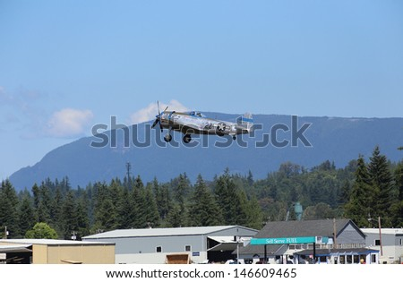 ARLINGTON -  JULY 13: A restored World War II P-47 D Thunderbolt was seeing flying in the skies over Arlington Air Field on 13 July 2013  near Seattle, WA. - stock photo