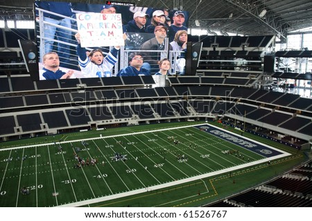 ARLINGTON - JUNE 17: Taken in Cowboys Stadium, Arlington, TX., on Thursday, June 17, 2010. Cowboys Stadium and giant video monitor. Super Bowl XLV will be played here in 2011. - stock photo