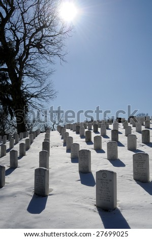 ARLINGTON - March 3: The heaviest winter storm of the year leaves Arlington National Cemetery covered in snow on March 3, 2009. - stock photo