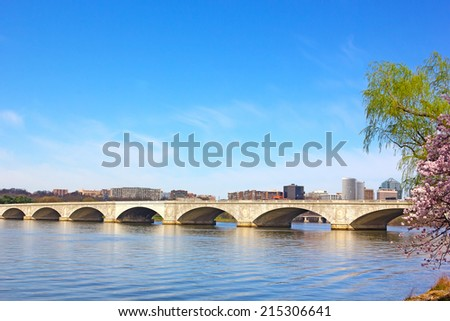 Arlington memorial Bridge during cherry blossom in Washington DC. A view on Potomac River and Arlington Memorial Bridge in the morning. - stock photo