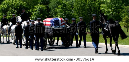 Arlington National Cemetery with Honor Guard escorting flag-draped casket on caisson - stock photo