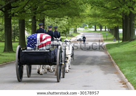 Arlington National Cemetery with horse drawn caisson carrying flag draped casket - stock photo