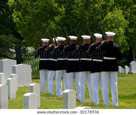 Arlington National Cemetery with military Honor Guard preparing to fire a final salute - stock photo